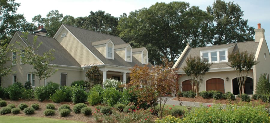 How to choose roof colors example of creamy beige siding with light tan grayish colored roof shingles
