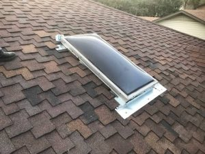 completed skylight repair with new shingles and correctly installed flashing underneath